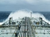 stock photo of big-rig  - oil tanker ship on open rough sea - JPG