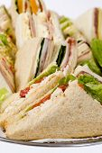 picture of catering service  - Close up shots of assorted sandwich triangles on a catering party platter - JPG