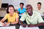 stock photo of young adult  - group of adult african american students in classroom - JPG