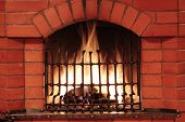 Fireplace with iron lattice in country house