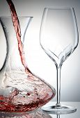 Pouring red wine into decanter