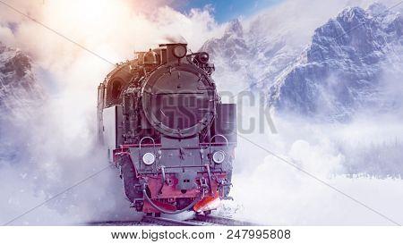 steam powered locomotive dashing through