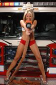 beautiful blond woman on a fire engine