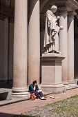 Girl Sitting Near The Marble Statue Of The Statue Of The Italian Mathematician Inventor Of The Axono poster