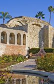 Mission San Juan Capistrano Statue And Bells poster