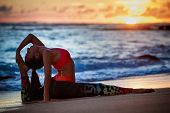 Sunset Meditation. Young Active Woman Stretching In Yoga Pose On Sea Beach To Keep Fit And Health. H poster