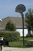 foto of bounce house  - family basketball hoop outside on the driveway - JPG