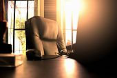 Big Boss Chair, Notebook And Stamp On The Table With Sunray On The Background poster