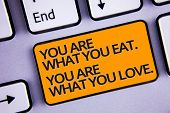 Word Writing Text You Are What You Eat. You Are What You Love.. Business Concept For Start To Eat He poster