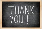 Thank you blackboard sign. Thank you written with chalk on black chalkboard with frame.