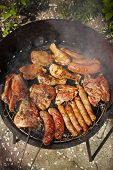 Meat On Barbecue, Variety Of Meat On An Outdoor, Sunlit, Smoking Barbecue Grill poster