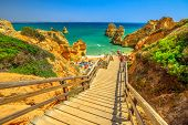 Wooden Walkway To Scenic Praia Do Camilo In Lagos Coast, Algarve, Portugal. The Long Stairs To Clear poster