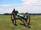 Civil War Cannon With House In Background poster