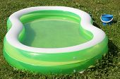 Color photo of an inflatable pool on grass