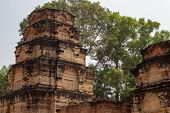 Ancient Stone Ruin Of Kravan Temple, Angkor Wat, Cambodia. Ancient Temple Tower In Forest. Angkor Wa poster