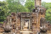 Ancient Stone Ruin In Angkor Wat Temple. Small Shrine With Lion Statue. Khmer Heritage Temple Ruin I poster