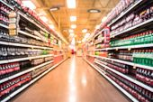 Abstract Blurred Soft Drinks Aisle With Customer Shopping poster