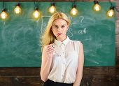 Sexy Teacher Concept. Woman With Long Hair In White Blouse Stands In Classroom. Teacher With Glasses poster