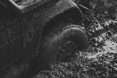 Competition Of Off-road Cars. Fragfment Of Car Stuck In Dirt, Close Up. Dirty Offroad Tire Covered W poster