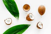 Tropical Composition With Coconut. Whole Coconuts And Coconut Cut In Half Near Pulm Leaves On White  poster