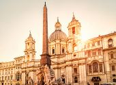Navona Square In Sunlight, Rome, Italy. Santagnese Church And Four Rivers Fountain With Egyptian Ob poster
