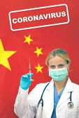Virus In China. Portrait Of Female Doctor Or Nurse In Blue Gloves Holding Syringe For Vaccination An poster