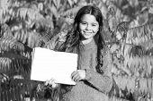 Small Child Enjoy Reading Autumn Foliage Background. Little Child Enjoy Learning In Autumn Park. Kid poster