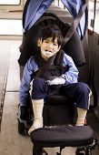 stock photo of physically handicapped  - Disabled little preschool boy in wheelchair on bus - JPG