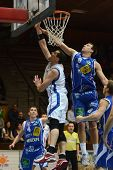 KAPOSVAR, HUNGARY - FEBRUARY 22: Jozsef Lekli (in white) in action at a Hungarian Cup basketball gam