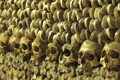 pic of catacombs  - piles of bones an skulls inside Les Catacombes - JPG