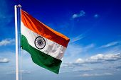 stock photo of indian flag  - India indian flag in blue sky - JPG
