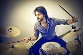 handsome musician playing drums