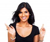 portrait of cheerful woman wishing good luck on white background