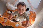Portrait of a cute baby in playpen