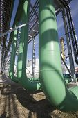 foto of ethanol  - Large green pipes at an ethanol plant - JPG