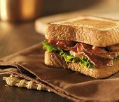 BLT bacon lettuce tomato sandwich on a napkin with copyspace composition