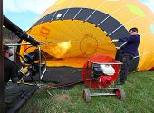 KARLSTEJN, CZECH REPUBLIC - APRIL 14: Unidentified crew preparing hot air baloon to fly. Baloon even