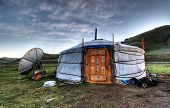 stock photo of ulaanbaatar  - Mongolian dwelling on the green plain of grass - JPG