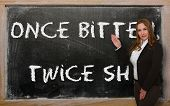 Teacher Showing Once Bitten, Twice Shy On Blackboard