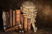 Antique judge's wig hanging on very old books