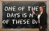 Teacher Showing One Of These Days Is None Of These Days On Blackboard