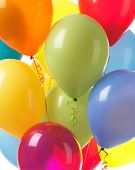 Colorful helium balloons abstract holiday party background