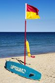 Lifeguard Flag, Surfboard And Flotation Device