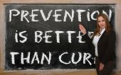 Teacher Showing Prevention Is Better Than Cure On Blackboard