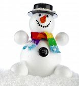 funny snowman with black hat sitting in a snowdrift isolated on white background