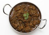 stock photo of kadai  - A kadai serving bowl of methi gosht - JPG