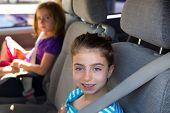 Kid children girls with safety belt in car vehicle indoor