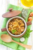 stock photo of stew pot  - Stewed cabbage with meat in a pot - JPG