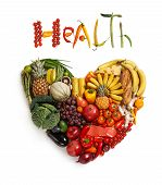 stock photo of vegetarian meal  - healthy food symbol represented by foods in the shape of a heart to show the health concept of eating well with fruits and vegetables - JPG