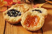 picture of shortbread  - Gourmet shortbread cookies filled with jams on a rustic autumn setting